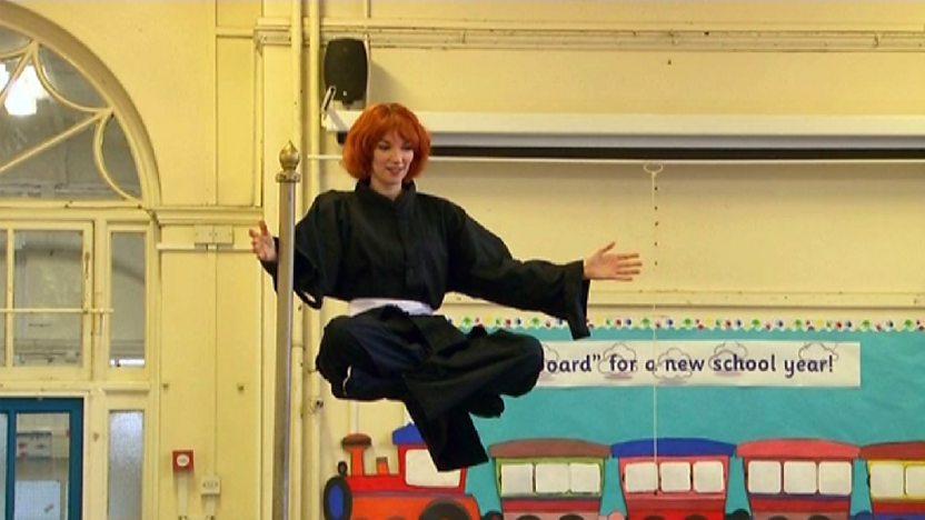 Katherine Mills levitating