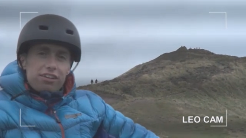Leo on a bike riding up a hill.
