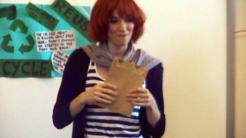 Katherine Mills holding an envelope