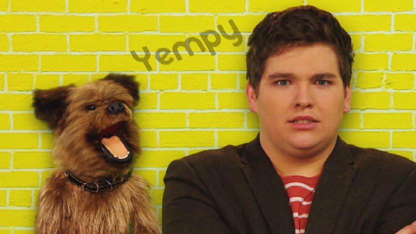Chris and Hacker T Dog on a yellow background with the word 'Yempy' inbetween them.
