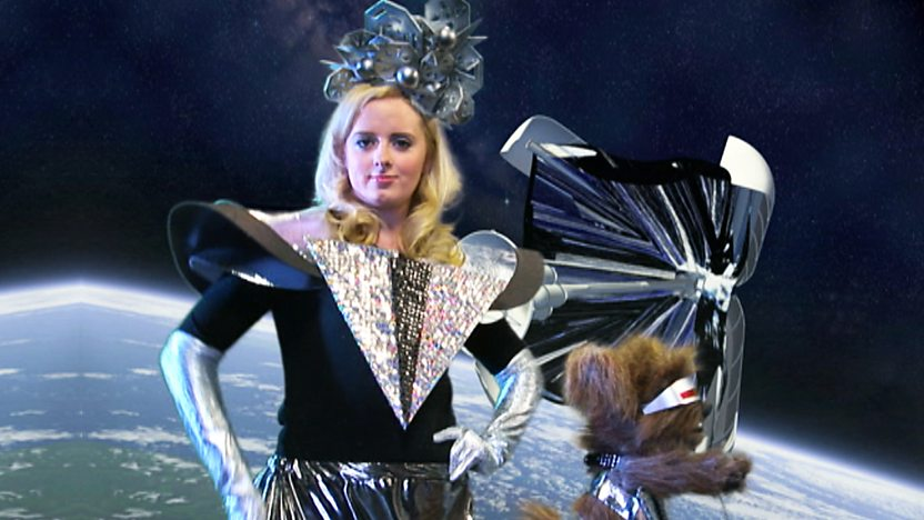 Katie Thistleton and Dodge T Dog on a space background dressed in futuristic outfits.