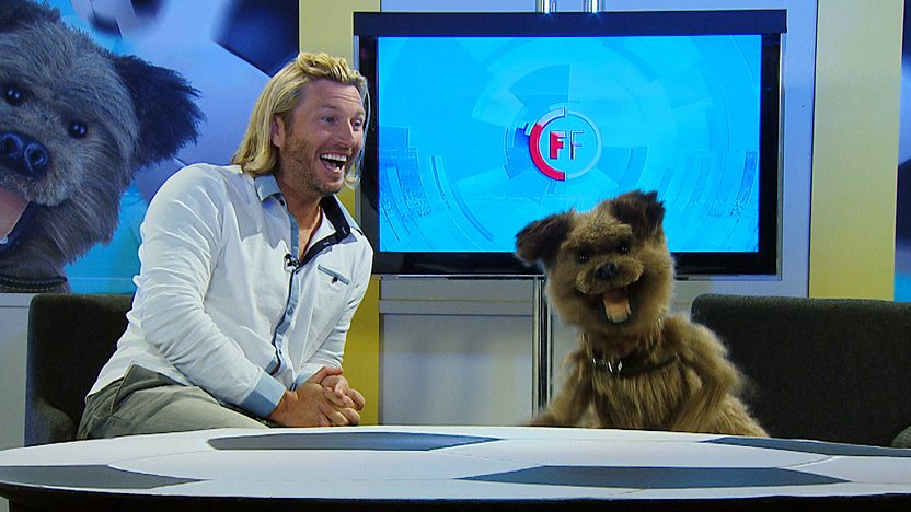 Hacker T Dog and Robbie Savage in the Football Focus studio laughing.