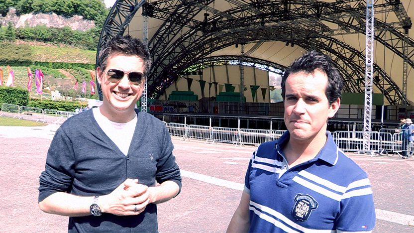 Dick and Dom stand in front of a stage at the Eden Project