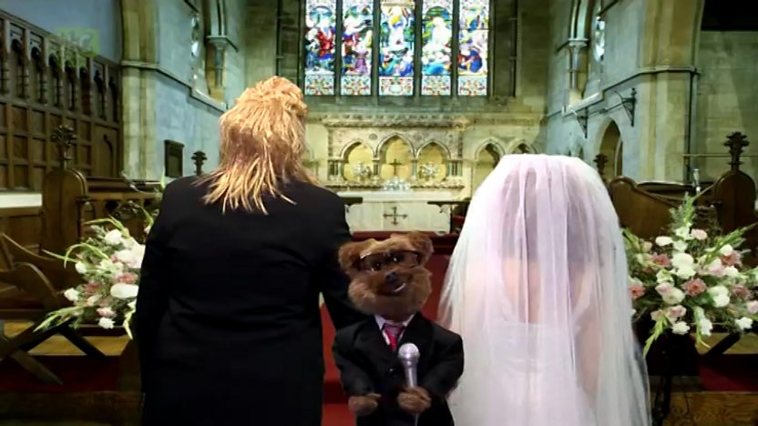 Hacker back to back with a wedding couple in a church