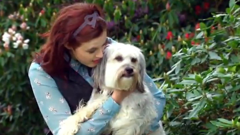 Ashleigh, from Britain's Got Talent, holding Pudsey the dog.
