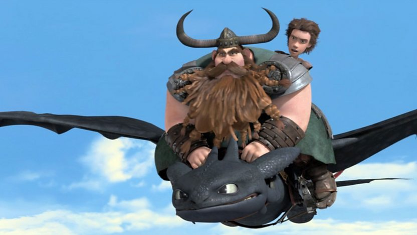 Stoik and Hiccup riding toothless as he flies through the sky.