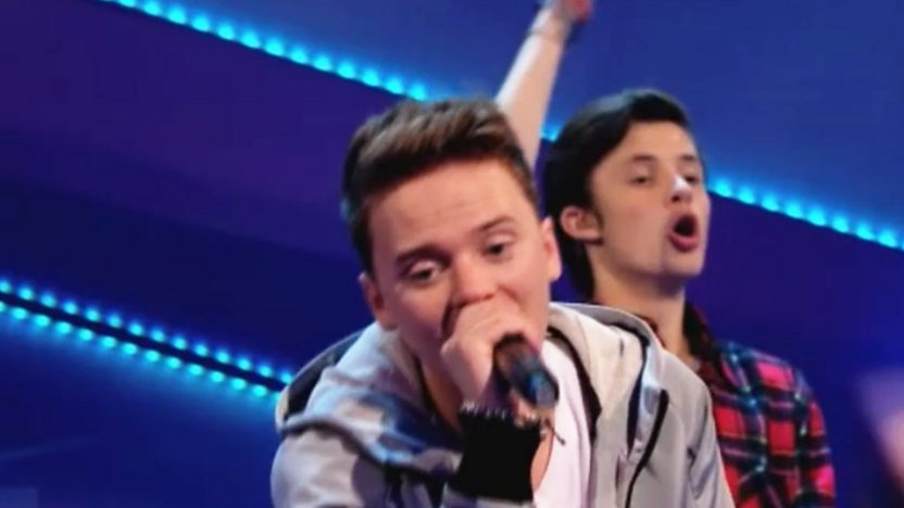 Conor Maynard performing on stage.