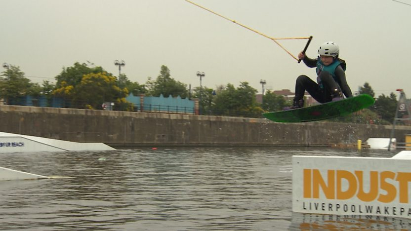 A wakeboarder jumping from a ramp