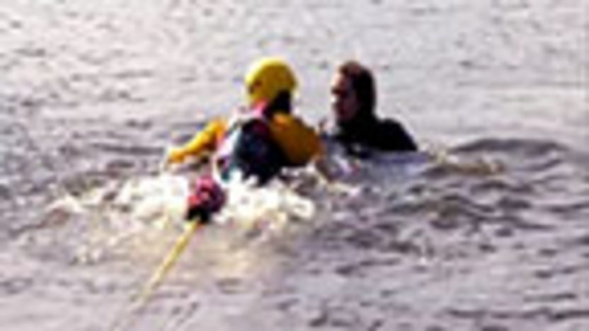 A cadet swimming to save a pretend casualty