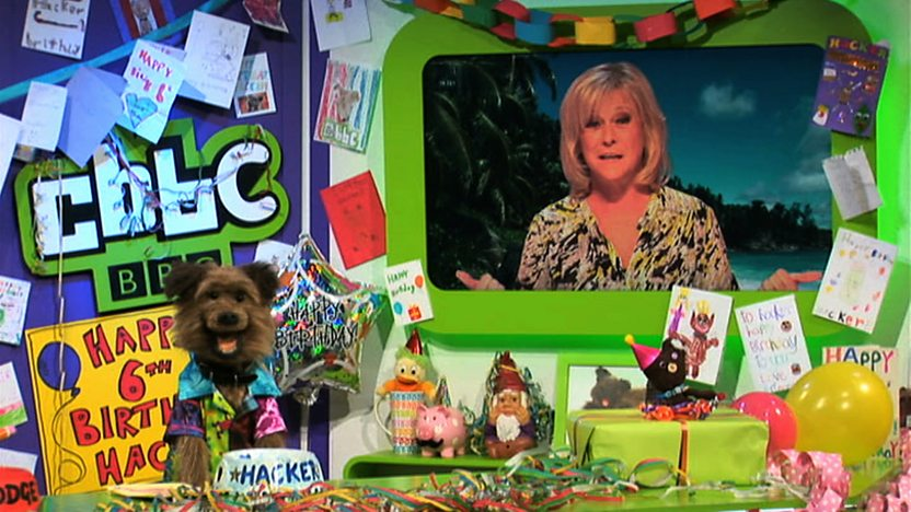 Sue Barker surprises hacker on the CBBC Office set