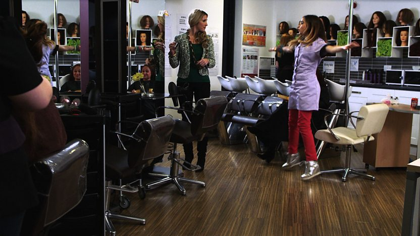 Aunt Val stands and watches angrily as Zoe-Marie does star jumps in the salon.