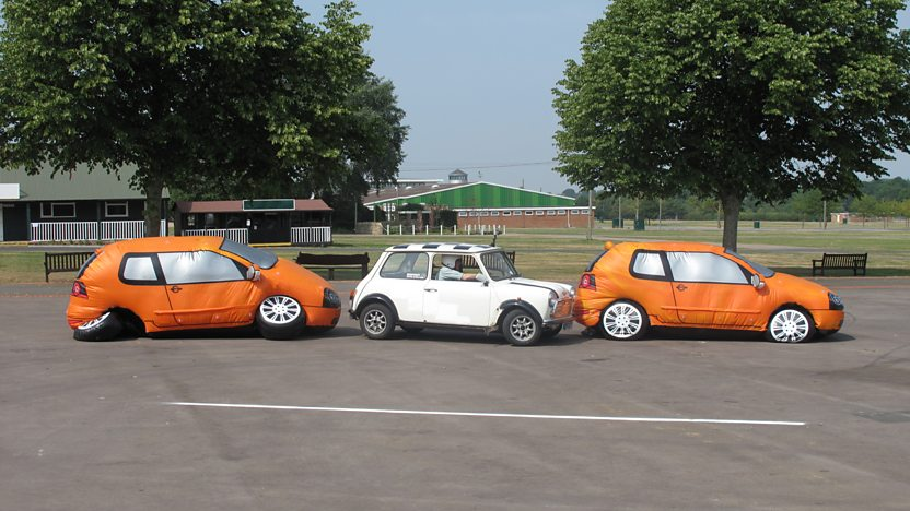 Orange and white cars in a line.