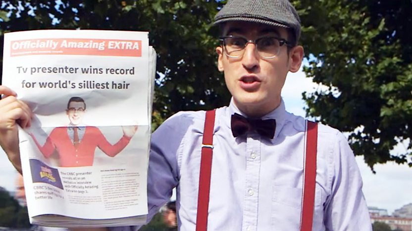 Ben Shires holding a news paper.