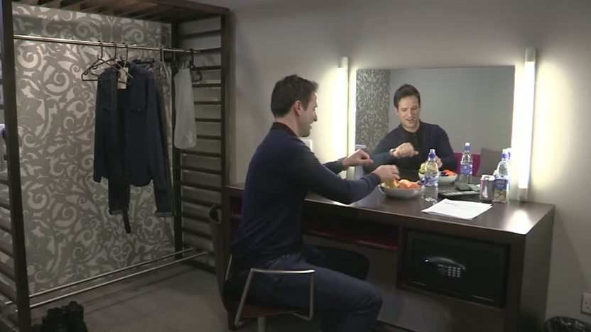 John in his dressing room.