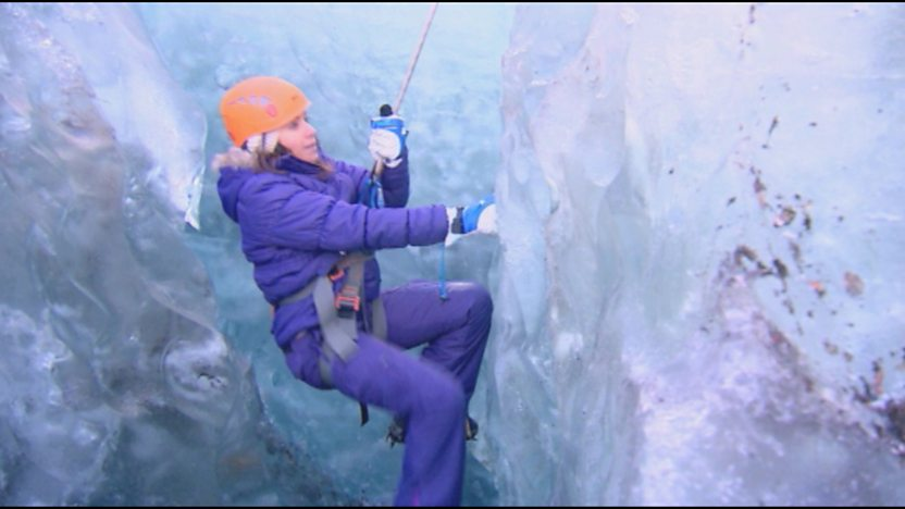 Claire climbing down the ice.