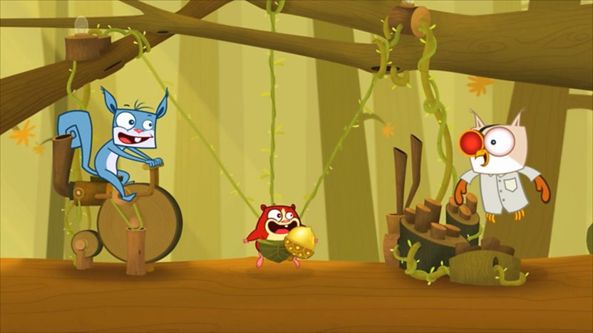 Fly-High riding a bike whilst Huggy is in a slingshot and Professor Von Hoot is flying around.
