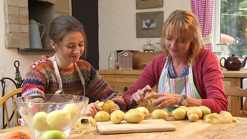 Alli and Sarah Boulsworth from Rocket's Island, peeling potatoes.