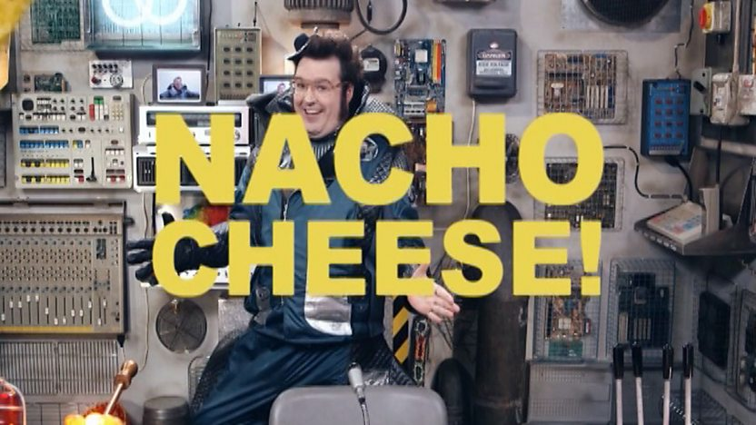 The Joke Master dancing behind the words 'Nacho Cheese'.