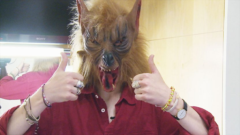 Cel Spellman wearing a scary wolf mask.