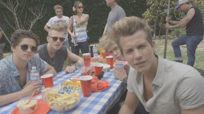 The Vamps having a picnic in their new music video.