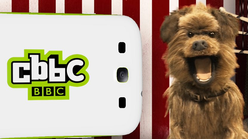 Hacker T Dog next to a CBBC branded mobile phone.