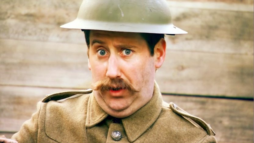 Shouty Man wearing a World War One soldier uniform in a trench.