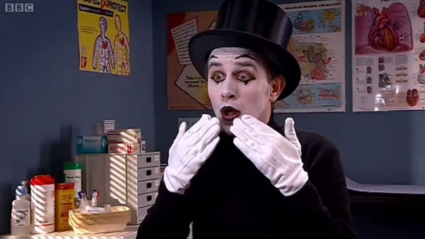 Man dressed up as a mime artist.