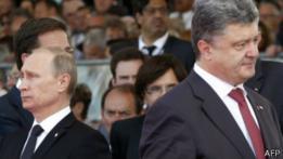 Vladimir Putin (izq.) y Petro Poroshenko (foto de archivo)