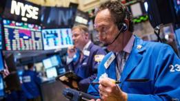 Corredores burstátiles en la Bolsa de Nueva York.