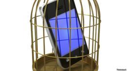 Teléfono dentro de una jaula