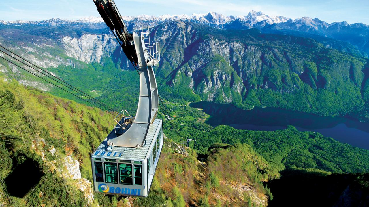 A cable car pulls up to the snow-covered top of Mount Vogel (Credit: Credit: Turizem Bohinj)
