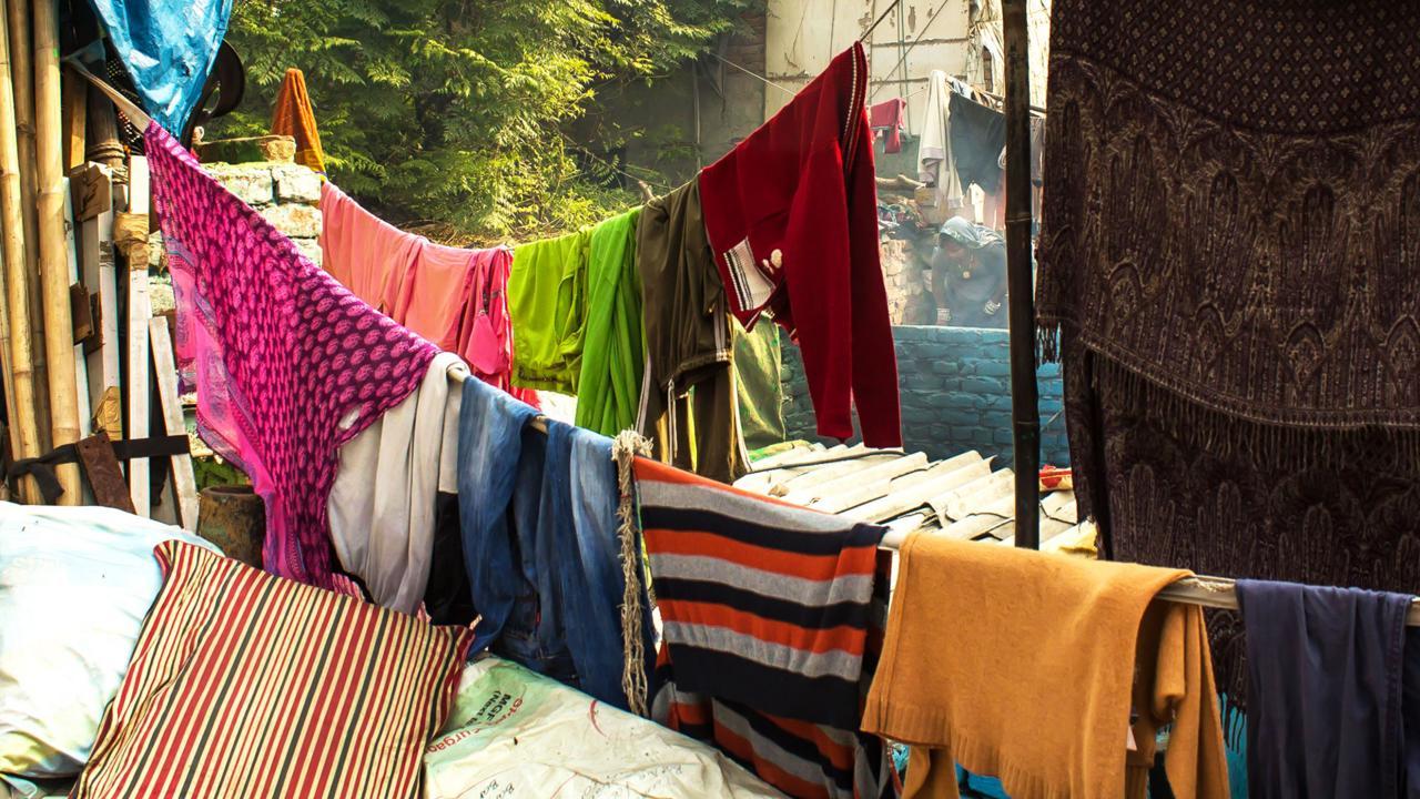 Colourful laundry lines crisscross Kathputli (Credit: Credit: Mariellen Ward)