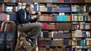 A man in a book shop (Credit: Photo: Corbis)