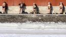 Residents sunbathe near the wall of the Peter and Paul Fortress, St Petersburg (Credit: Elena Palm/AFP/Getty)
