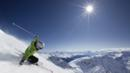 A skier descends from the top of a peak overlooking Davos, Switzerland (Thinkstock) (Credit: Thinkstock)