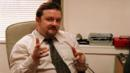 Ricky Gervais stars as inept middle-manager David Brent in The Office (BBC) (Credit: BBC)