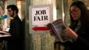 People looking for work browse vacancies at a US jobs fair (Getty Images) (Credit: Getty Images)