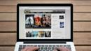 A laptop shows the front page of IMDb (Credit: Corbis)