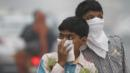 Children cover their mouths in Delhi. (Sanjeev Verma/Hindustan Times/Getty Images) (Credit: Sanjeev Verma/Hindustan Times/Getty Images)