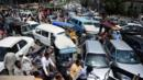 Pakistani commuters are stuck in a traffic jam. (AFP/Getty Images) (Credit: AFP/Getty Images)