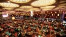 Tourist pile in to gamble at Macau's casinos, Grand Lisboa, China (Credit: Credit: AFP/Getty)
