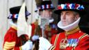 A Beefeater stands outside of Westminster Abbey, London, Yeoman Warder (Credit: Credit: Carl de Souza/Getty)