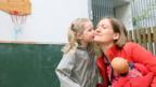 A three-year-old German girl kisses her mother goodbye. (Adam Berry/Getty Images)