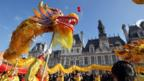 Dancers usher in Chinese New Year with a dragon dance in Paris (AFP/Getty)