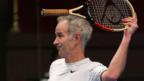 Tennis star John McEnroe struggles to remain polite on court (Getty Images)