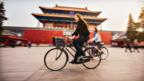 Living abroad can broaden your horizons. Two women cycle in Beijing. (Getty Images)