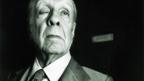 Borges at the front door of his apartment in Buenos Aires, 1983 (Getty Images)