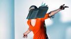 A woman throws a book