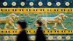 People walk in front of the Great Gate of Ishtar at the Pergamon Museum
