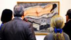 Museum-goers view a nude by Marc Chagall. (Credit: Philippe Huguen/AFP/Getty Images)